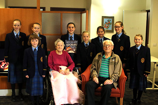 Students read to senior citizens