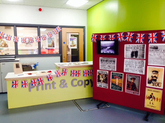 Library display with World War 1 recruitment posters and news articles.