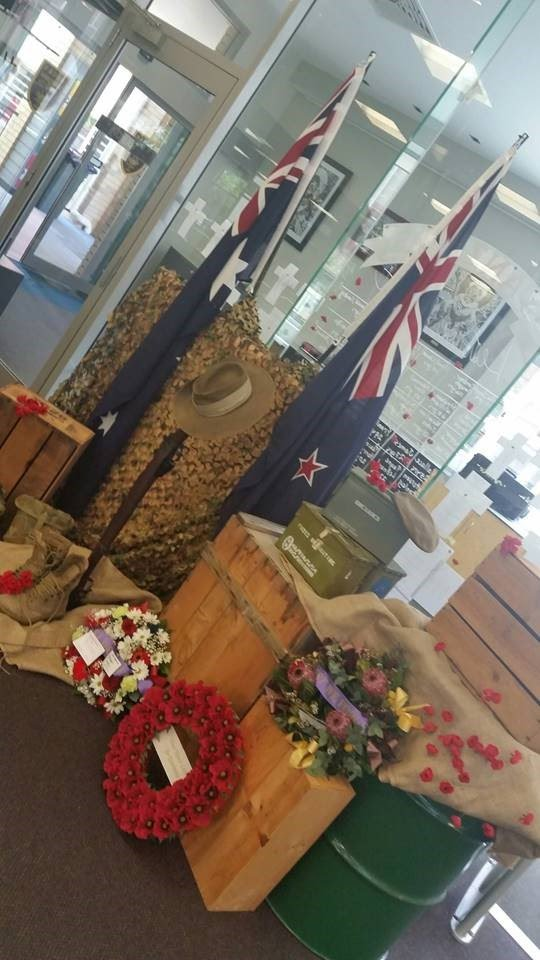 ANZAC themed library display with wreath and flags